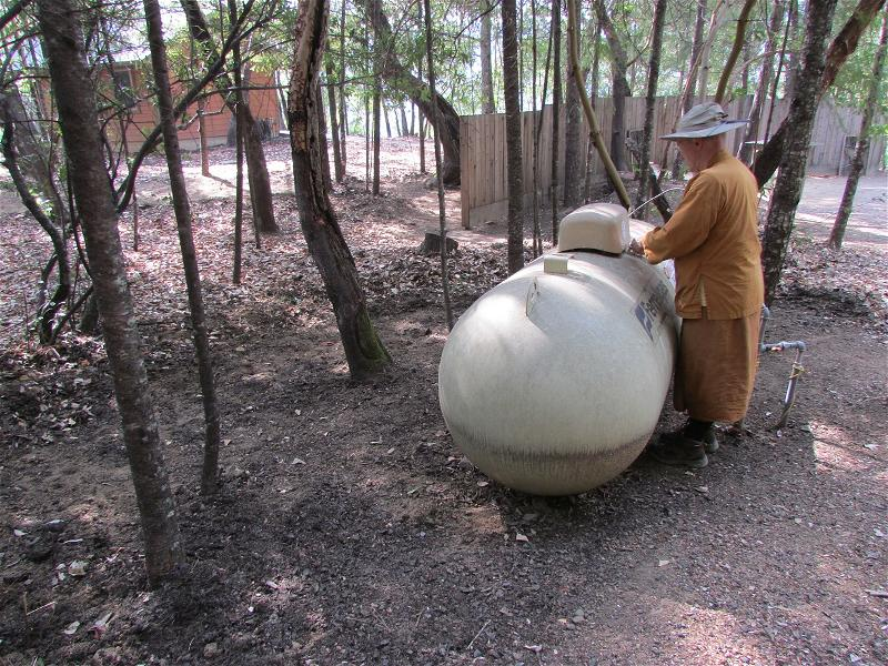 Ajahn Pasanno checking the propane tanks